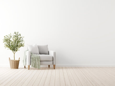 Traditional living room interior mockup with grey armchair and green throw standing by olive tree in wicker basket on empty white wall background. 3d rendering, illustration