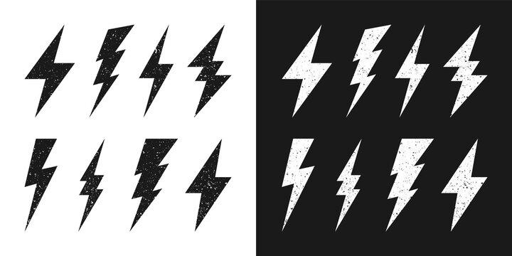 Black and white lightning bolt icons with grunge texture. Vintage flash symbol, thunderbolt. Simple lightning strike sign. Vector illustration.