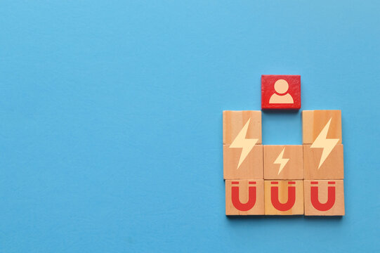 Wooden blocks with magnet icons pull a person in a row blocks. Recruiting and search talent workers concept.