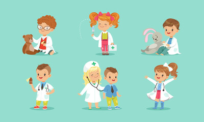 Set of Cute Kids Playing Doctors, Cheerful Little Boys and Girls Examining and Treating their Patients with Medical Tools Cartoon Vector Illustration - fototapety na wymiar