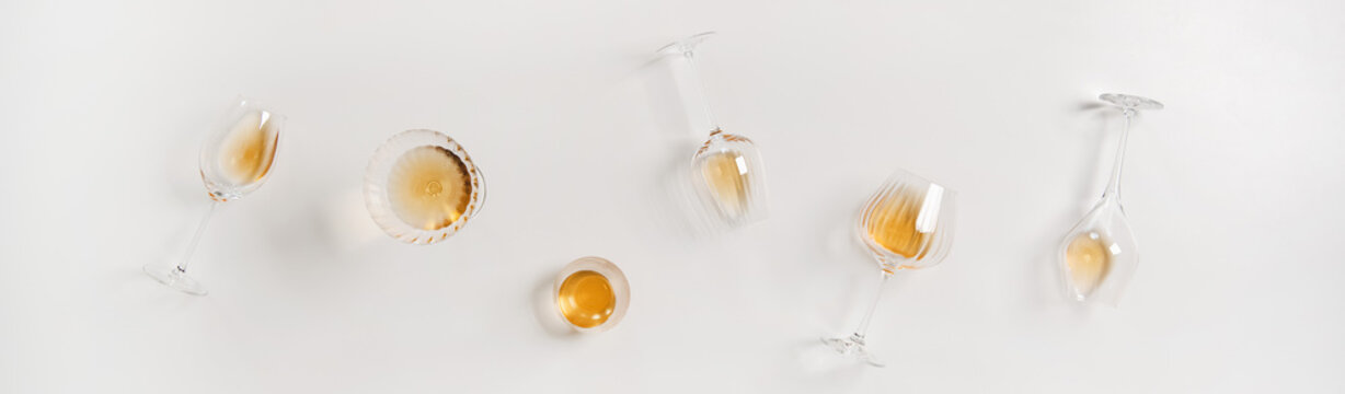 Trendy Orange or Amber wine in different glasses, wide composition