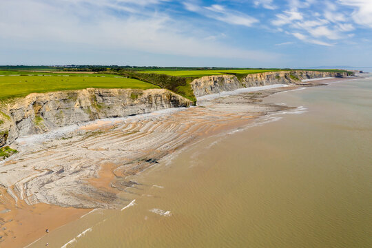 Aerial view of dramatic limestone cliffs and coastline at Southerndown, Wales
