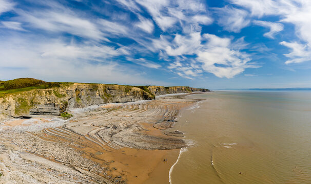 Aerial view of spectacular coastal limestone cliffs and ocean at Southerndown, Wales. UK