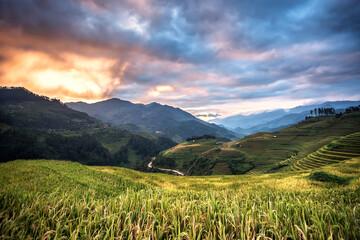 Beautiful Sunset on terraced rice field in harvest season in MuCangChai, Vietnam