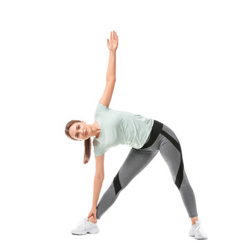 Sporty young woman training against white background