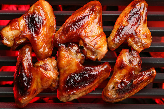 Roasted chicken wings cooking on grill
