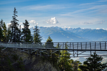 Obraz Suspension bridge on walking trail near Crans Montana in canton of Valais - fototapety do salonu