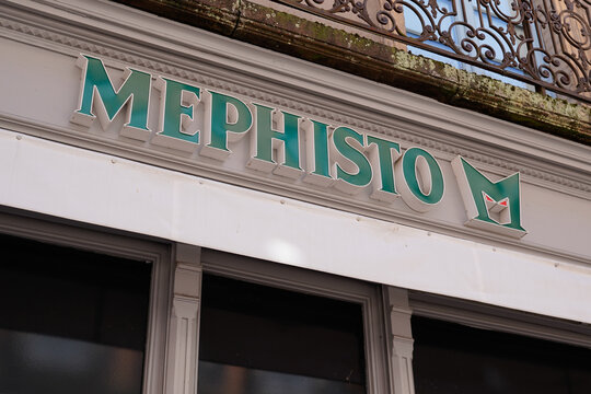 Mephisto logo brand and green text sign of footwear store shoes shop boutique