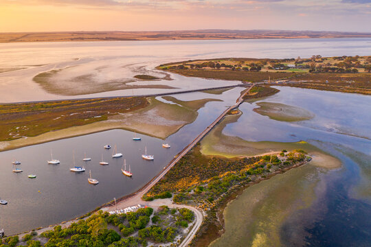 Aerial view of roads joining islands in a coastal bay at sunsets