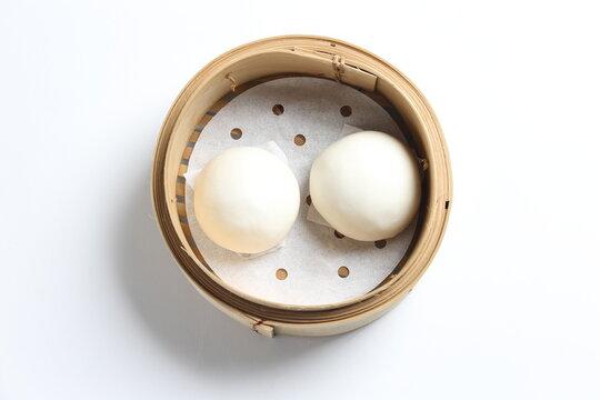 steamed yellow sweet salted egg yolk custard lava bao white round bun in bamboo basket dim sum menu