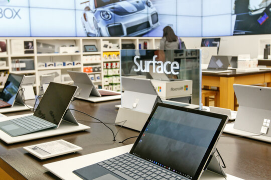 Variety of laptops running Windows Surface for sale at a Microsoft store in Prudential Center in Boston.