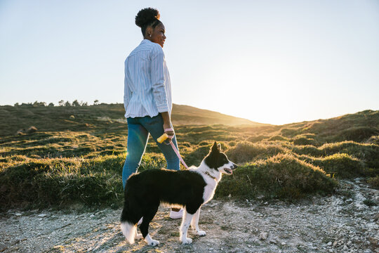 Woman with dog walking in nature