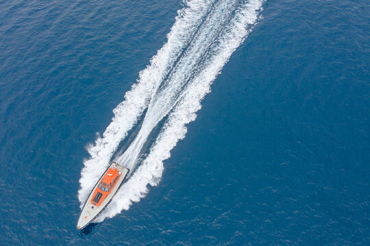 Looking down on pilot boat speeding through the water
