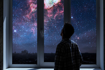 Fototapeta person standing next to the window and watching outside, admire the star on night sky, elements of this image furnished by nasa obraz