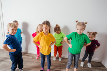 Group of children doing gymnastics in kindergarten or daycare