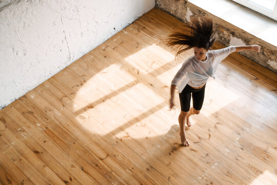Young brunette white woman dancing contemporary
