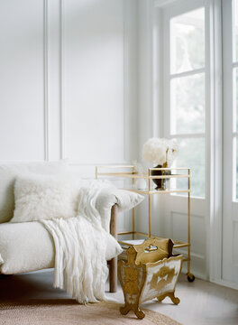 White interior with brass touches for a brightly lit home