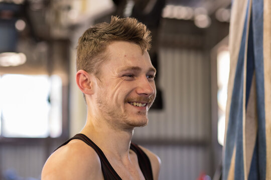 young guy shearer sweaty and smiling at the end of a run