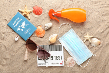 Immune passport, covid-19 test result and medical mask on beach