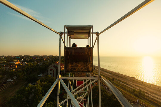 RUSSIA, YEYSK - AUGUST 20, 2016: View of the Sea of Azov and the small tourist town of Yeysk from above of the Ferris wheel at sunset. Russia, Sea of Azov, Krasnodar Territory, Yeysk.