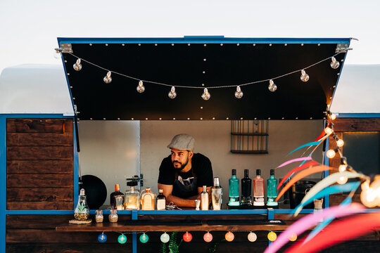 Young bearded male barman in food truck