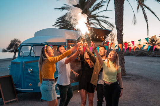 Group of happy people dancing near food truck