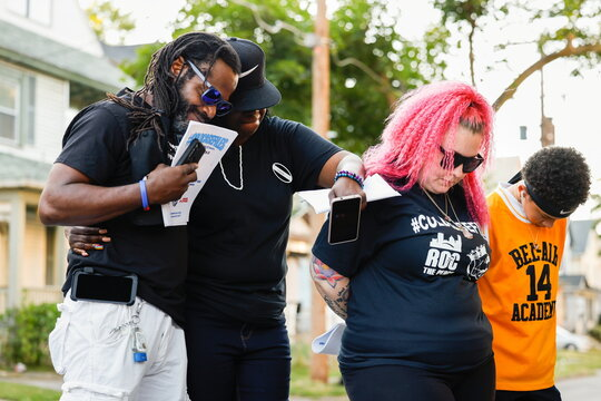 """John Rouse, Justine Harris and Courtney Allen comfort each other during prayer at """"PEACE UP, GUNS DOWN"""" rally in Rochester"""