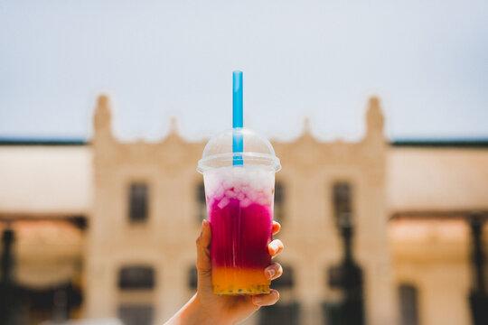 Crop hand with ice juice