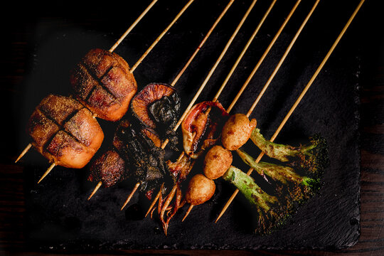 Flat lay of delicious grilled skewers