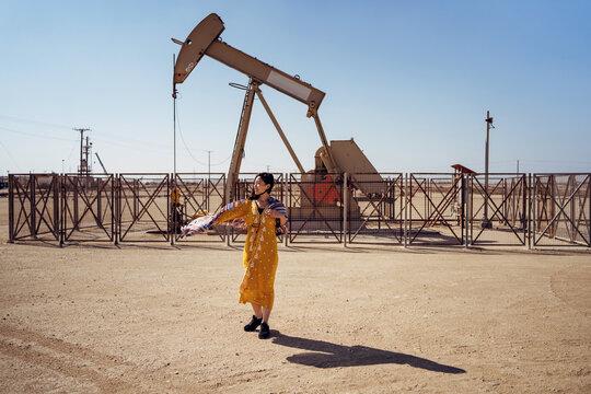 woman standing on oil field