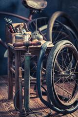 Vintage bicycle repair workshop with tools and wheels. Vulcanization workshop