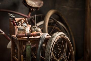 Vintage bicycle repair workshop with spare parts. Repair shop