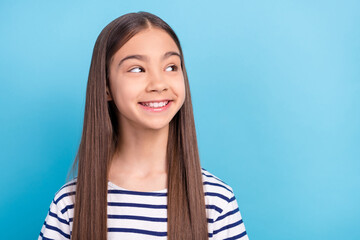 Photo portrait little girl wearing striped shirt smiling looking copyspace isolated pastel blue color background Wall mural