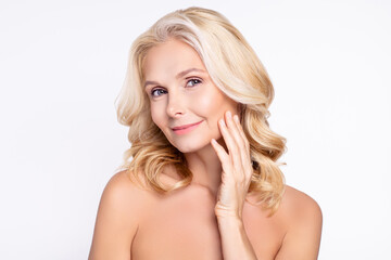 Obraz Portrait of attractive middle-aged woman touching smooth perfect fresh skin isolated over white color background - fototapety do salonu