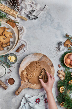 Top view of anonymous woman preparing desserts for christmas
