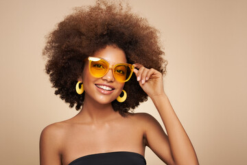 Beauty portrait of African American girl in sunglasses. Beautiful black woman. Cosmetics, makeup and fashion