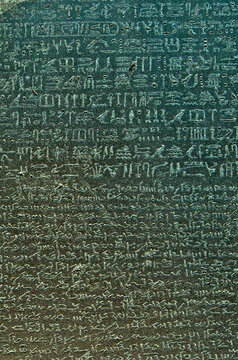 Closeup of Egyptian Hieroglyphs and Demotic script on the Rosetta Stone a granodiorite stele inscribed with a decree issued at Memphis in 196 BCE on behalf of King Ptolemy. British Museum, London