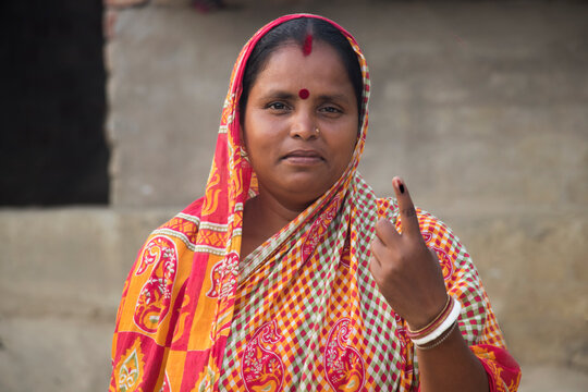 Indian Rural Woman voters mark on finger