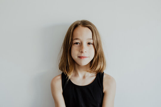 Pensive teen girl looking at camera against white background