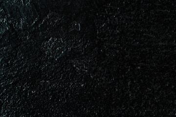Ciemne kamienne tło, skalna zniszczona tekstura.
