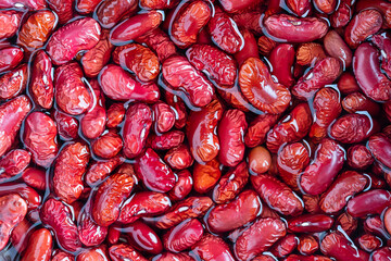 Obraz Red beans pattern as background in water, close up - fototapety do salonu