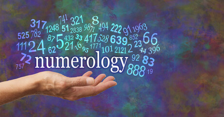 Fototapeta Numerology is in the palm of your hand  - female open palm with the word NUMEROLOGY floating above surrounded by numerous random numbers against a rustic rich modern abstract background  obraz