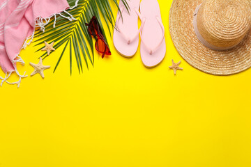 Obraz Flat lay composition with different beach objects on yellow background, space for text - fototapety do salonu