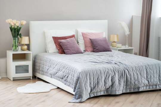 Beautiful modern bedroom, interior concept with crumpled bed linen