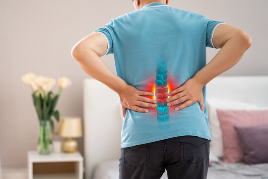 Lumbar spine hernia, man with back pain at home, compression injury of the intervertebral disc in the lower back