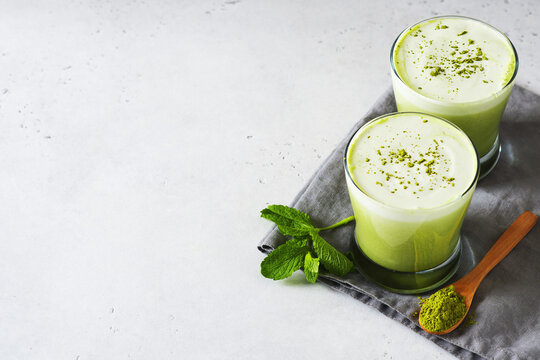 Green smoothie mint or matcha latte in glass