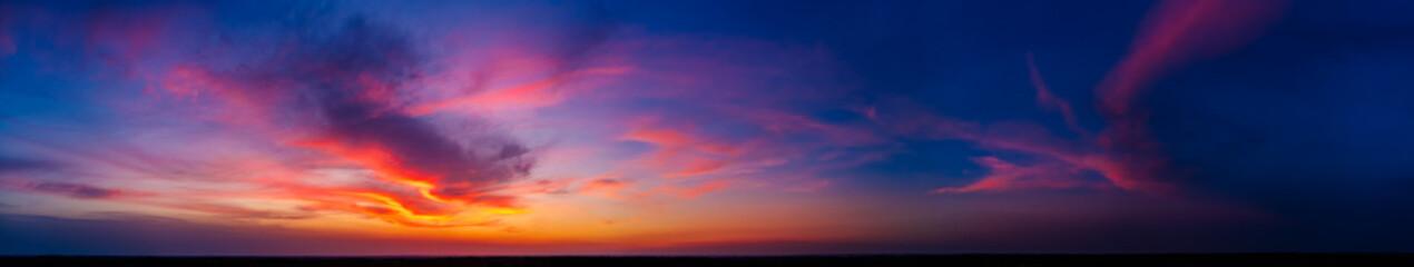 Fototapeta Dramatic wide panorama of late sunset with burning sky obraz