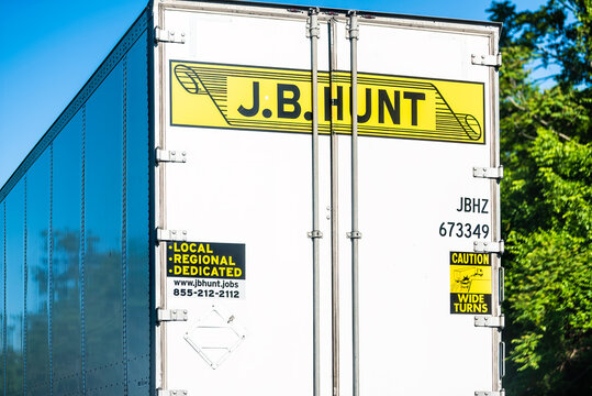 Front Royal, USA - May 27, 2021: Highway road i-66 in Virginia with yellow logo for JB Hunt cargo transportation truck on interstate highway road and local jobs for drivers