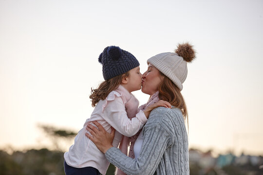 Mother and daughter sharing special moments together in winter