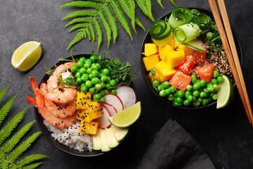 Fototapeta Poke bowls with shrimps, salmon, avocado and mango obraz